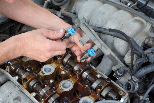 mechanic fixing fuel injector