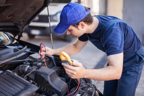 mechanic troubleshooting car engine
