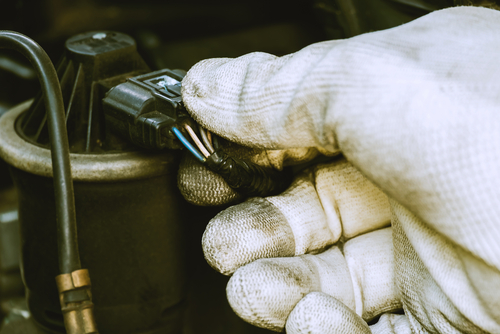 mechanic hand removing egr plug