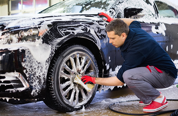 man cleaning car outdoors